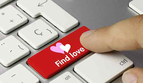 "A keyboard with a ""finding love"" sign in the Enter key."