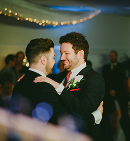A gay couple dancing.