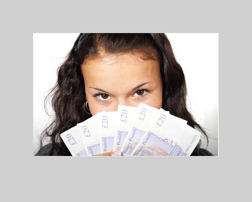 girl holding money behind face